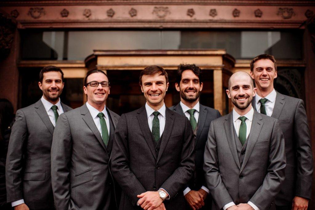 groom and 5 groomsmen outside of the lumber exchange