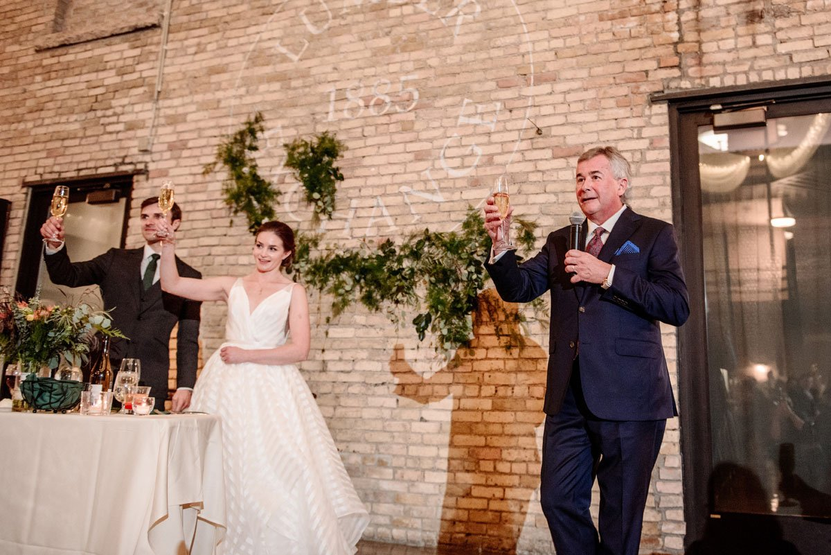 father gives toast during lumber exchange wedding reception