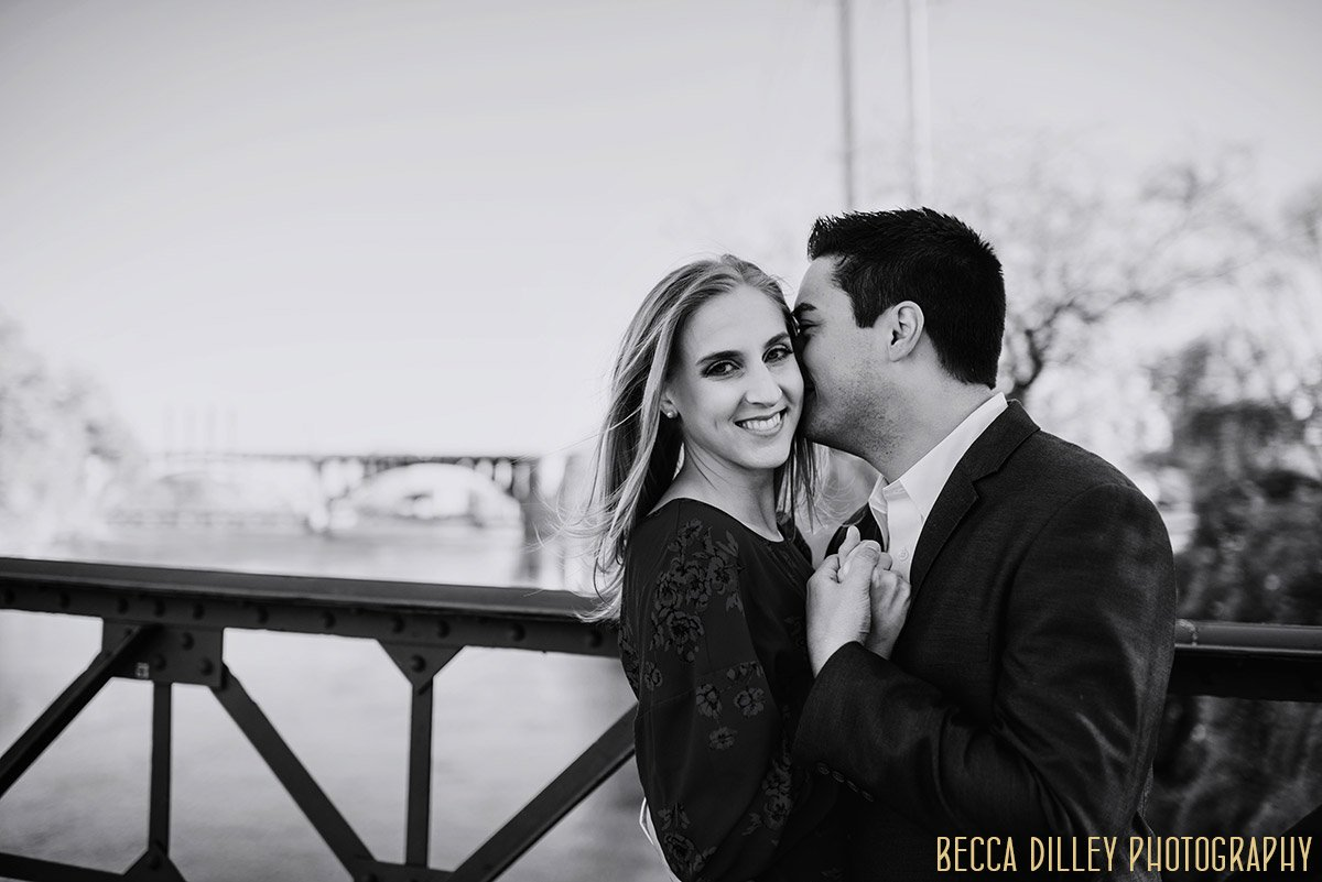couple laughing for engagemnet photos in black and white
