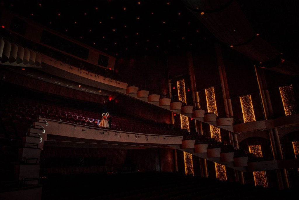 dramatic lighting for couple in balcony of washington pavilion wedding sioux falls
