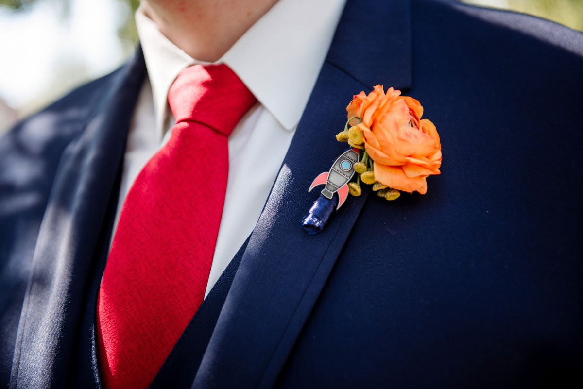groom with space race themed rocket on flowers