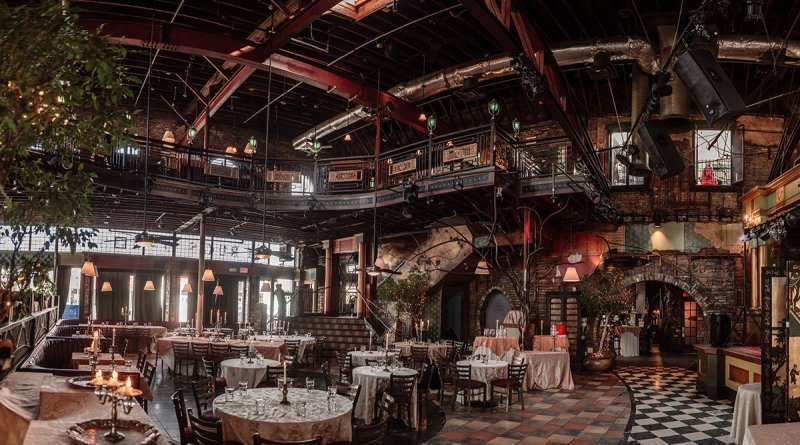 panorama of loring restaurant wedding minneapoils set up for dinner reception