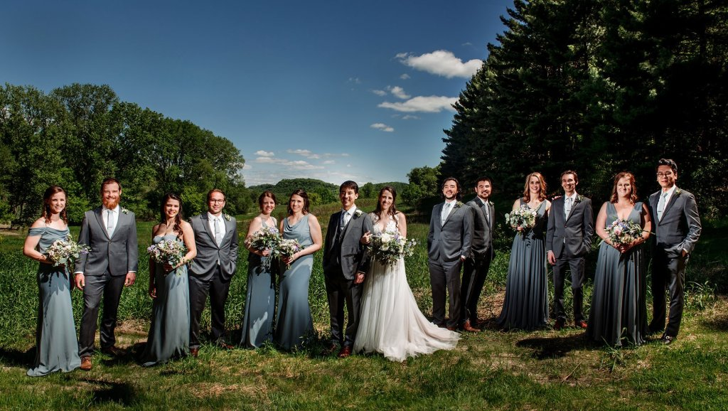 flash composite  of large wedding party wedding at round barn