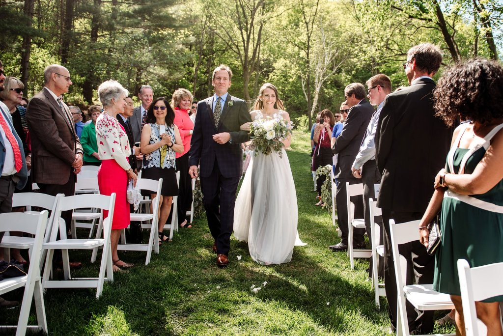 bride and father walk down aisle wedding at round barn