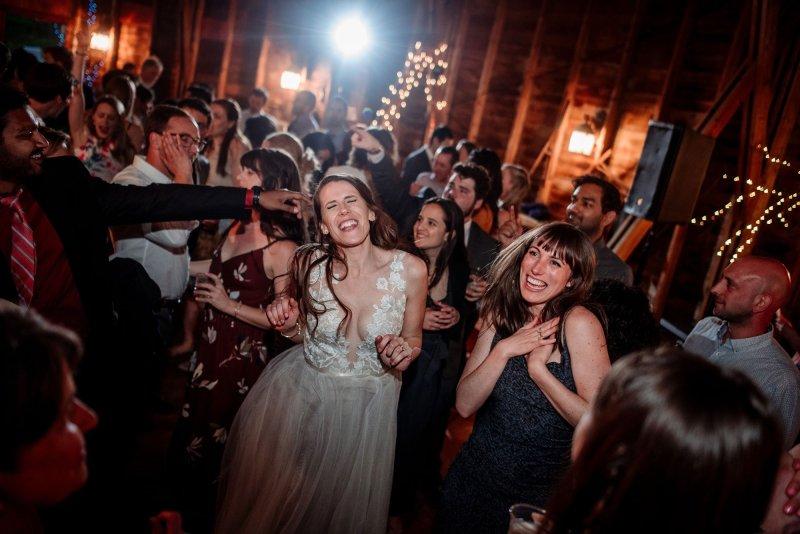 bride dancing in round barn at mn wedding