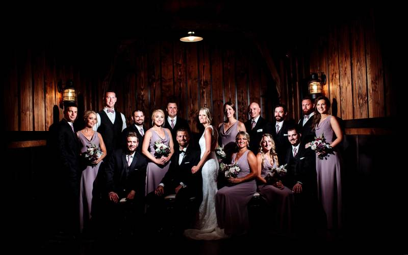 flash composite wedding party in cellar of 7 vines vineyard wedding mn