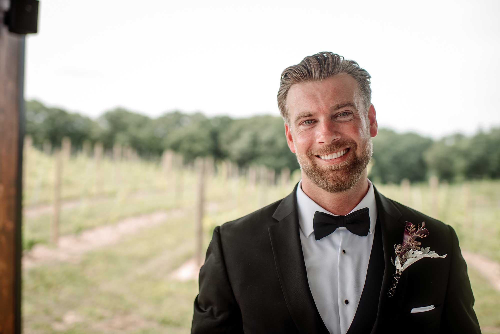 groom portrait 7 vines vinyard wedding mn