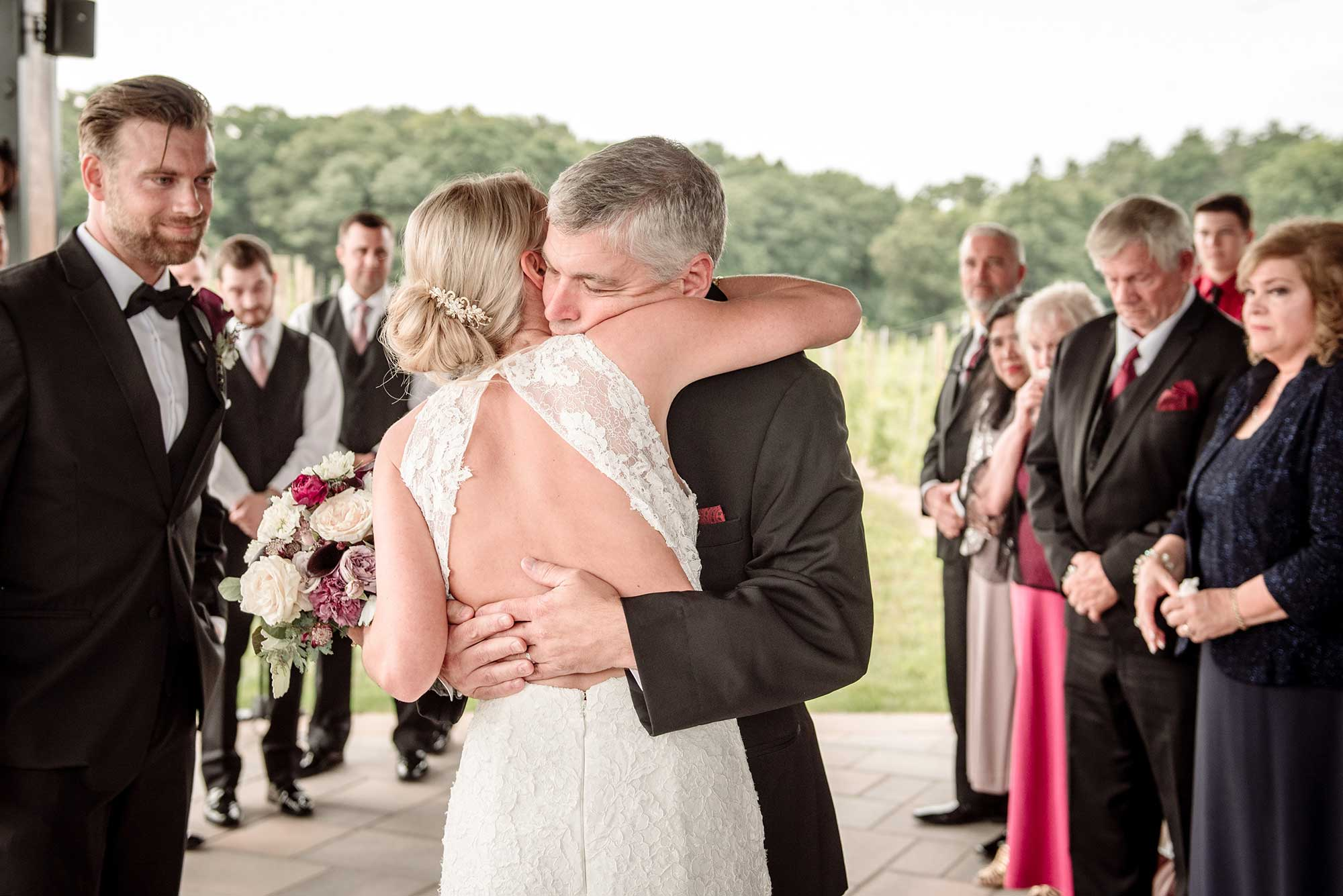 dad gives away bride at 7 vines vinyard wedding mn