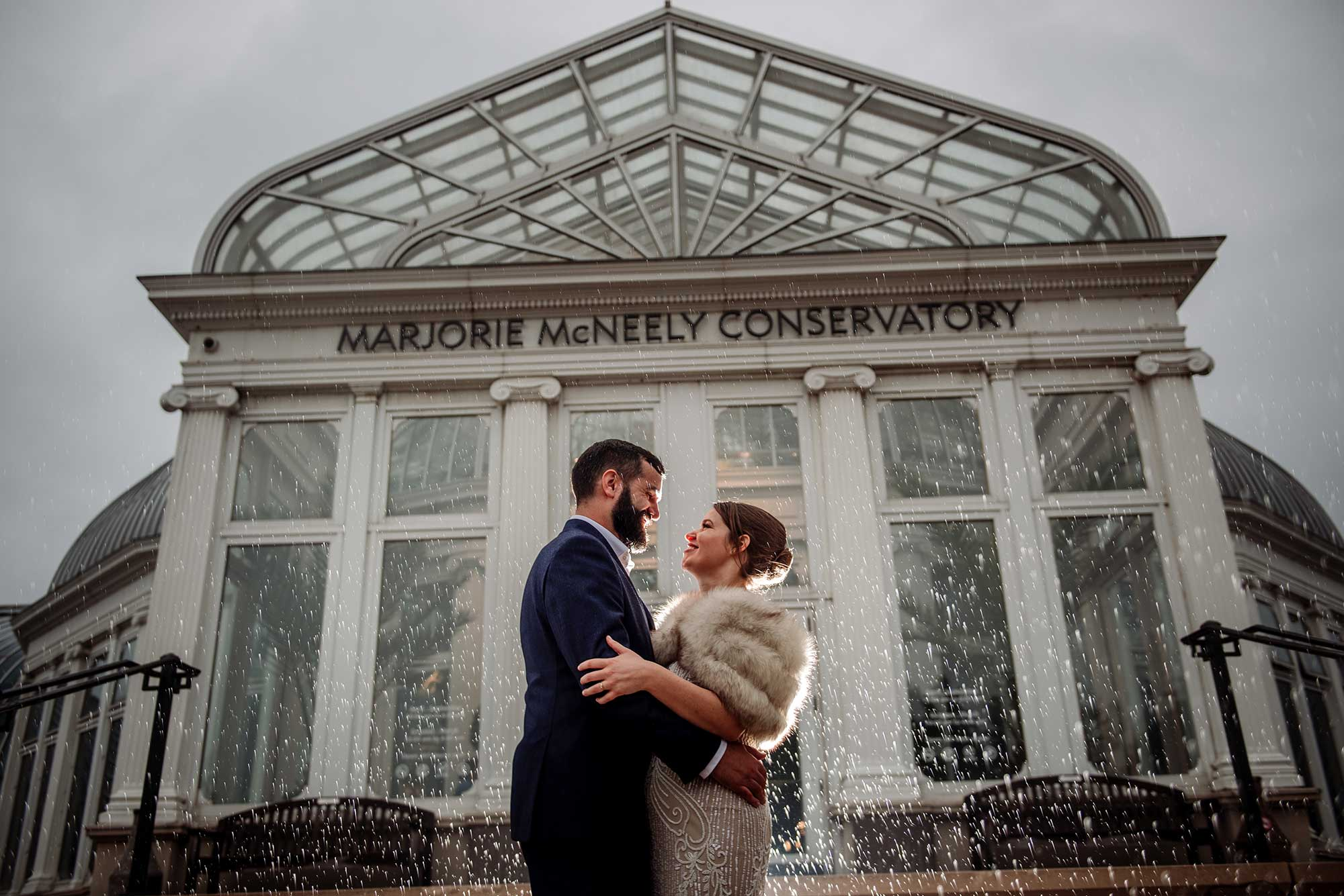 couple in rain outside of como conservatory wedding