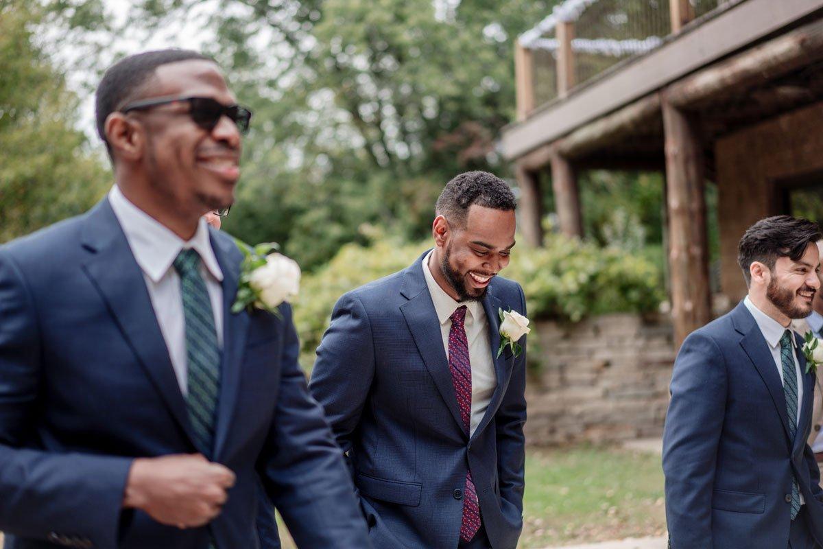 groom with groomsmen mn camp wedding