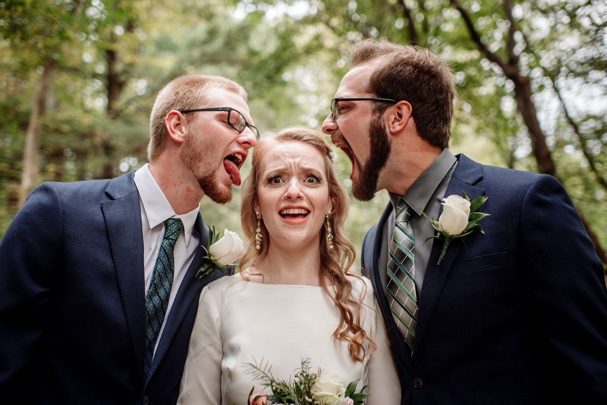 bride with two brothers making funny faces