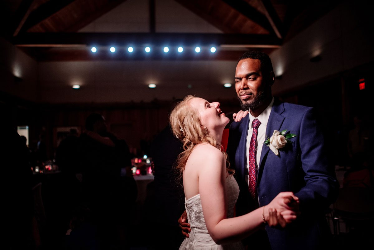 groom making funny face for first dance