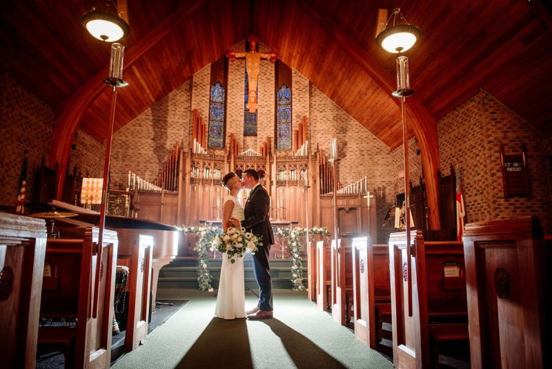 dramatic backlight in small church of couple small wedding with restaurant st paul mn