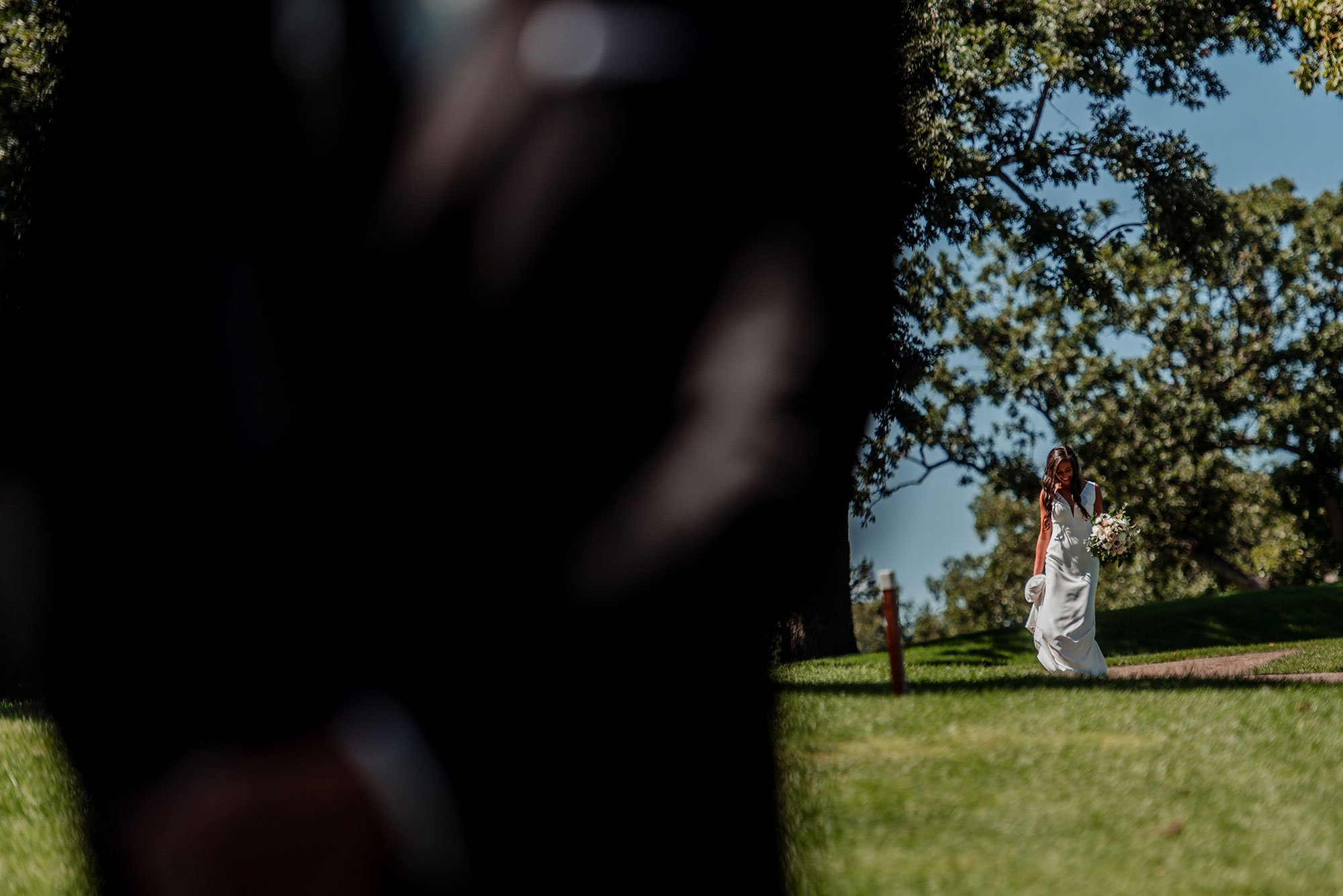 bride walking to husband for first time at interlachen country club mn