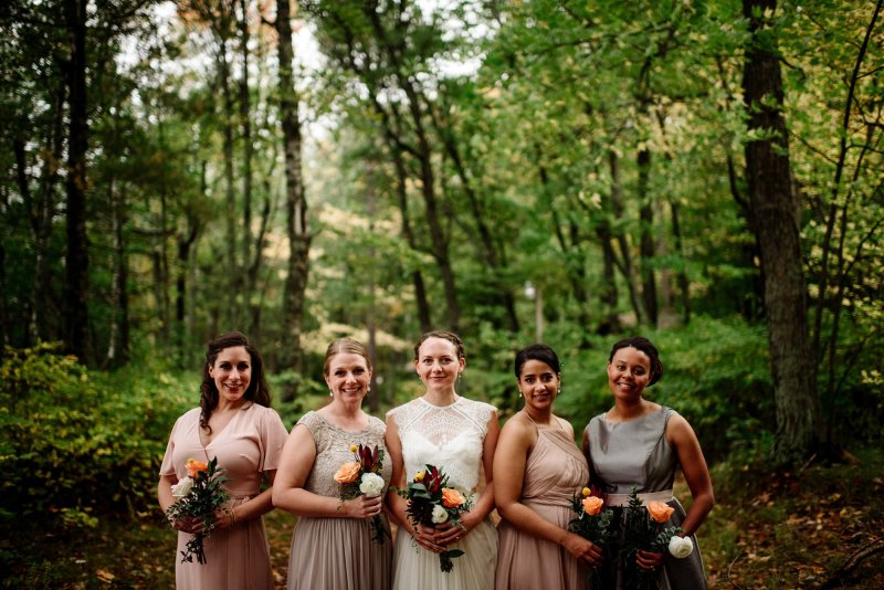 bride with 4 bridesmaids in blush and grey MN wedding at Camp Miller