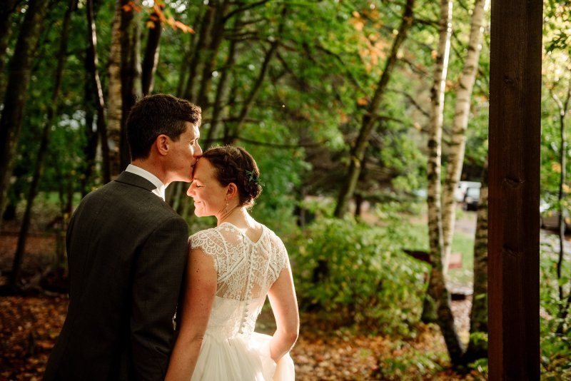 bride and groom with perfect light at MN wedding at Camp Miller