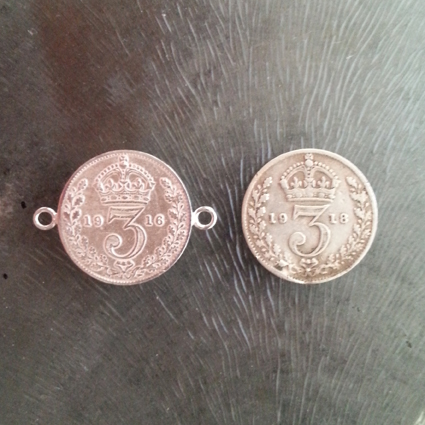 A clean, soldered and polished coin next to one of the original tarnished ones