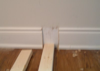 baseboard cuts to allow for 2x4 stud and drywall installation