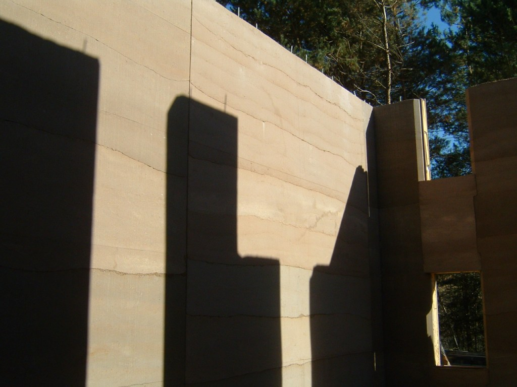 rammed earth walls before building in the floors