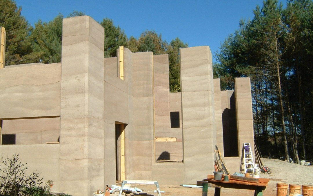 rammed earth house construction in progress
