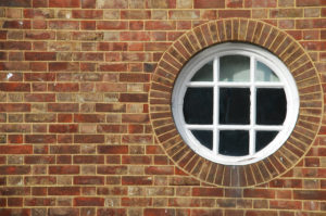 Round window, single-paned, terrible energy efficiency