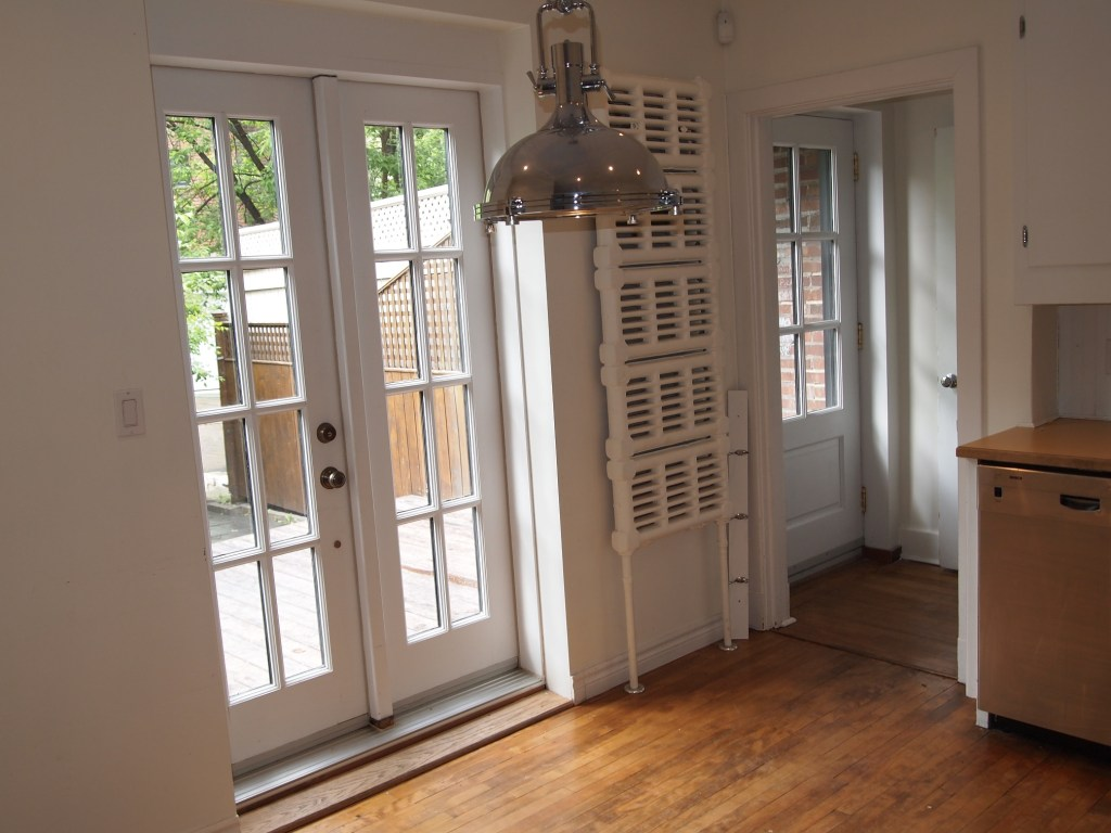 Patio doors and wonderful radiator that is being saved.