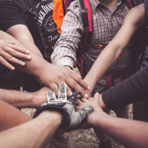 volunteers giving each other a group hand huddle