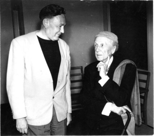Bruce Goff standing with Frank Lloyd Wright