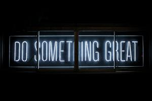 """neon sign that reads """"do something great"""""""