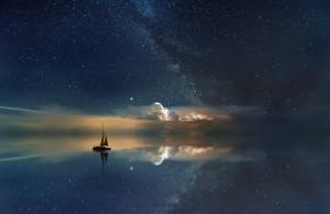 artistic photography of a sailboat and the night sky