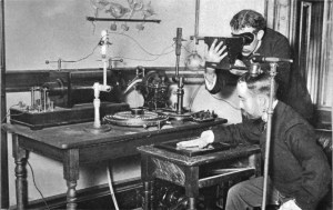 A photograph of an x-ray experiment being conducted using a Crooke's tube (left) between 1895 and 1899.