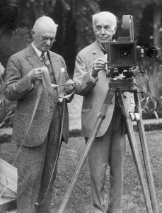 Thomas Edison (right) operates an old kinetograph while George Eastman looks at some film at a 1928 party.