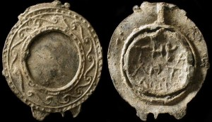 This is a lead cast for a glass mirror that was made in Ancient Rome in the 2nd or 3rd Century CE.
