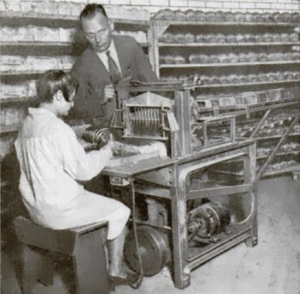 A 1930 demonstration of a bread slicing machine in St. Louis, Missouri.