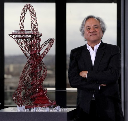 Anish Kapoor with a model of Orbit.
