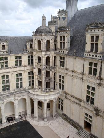 A view inside one of the courtyards of Château de Chambord, showing an elaborate staircase.