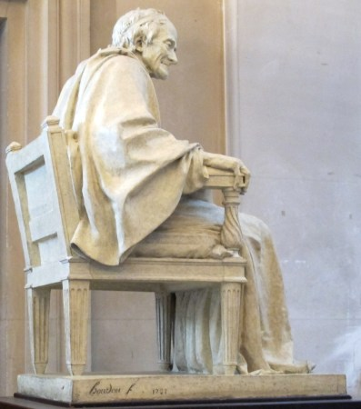 A side view of Houdon's Voltaire, Seated.