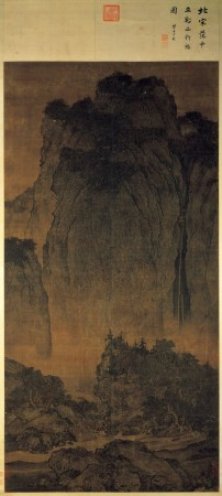 A magnificent landscape dwarfs the tiny figures of a man and his animals in Fan Kuan's Travelers Among Mountains and Streams.