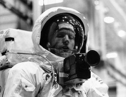 A 1969 photograph of Neil Armstrong, prior to his journey to the moon, showing the Hasselblad camera he used there.