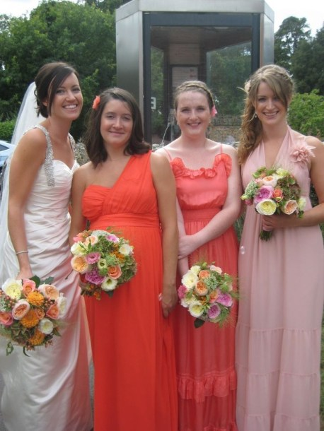 The bouquets compliment the mixed dress tones