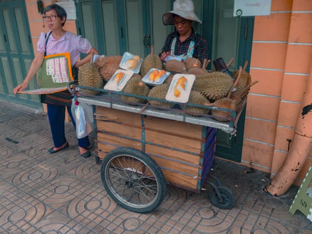 Man selling Durians on the streets of Bangkok