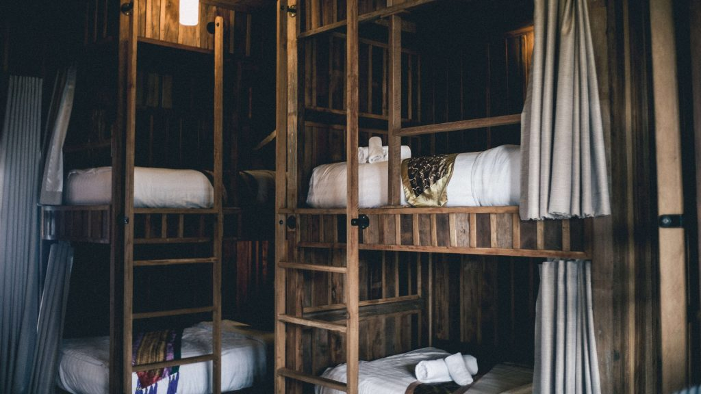 A hostel dorm with bunk beds