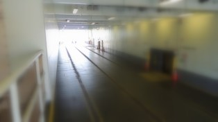 A shot the the car bay of the ferry before it is loaded.