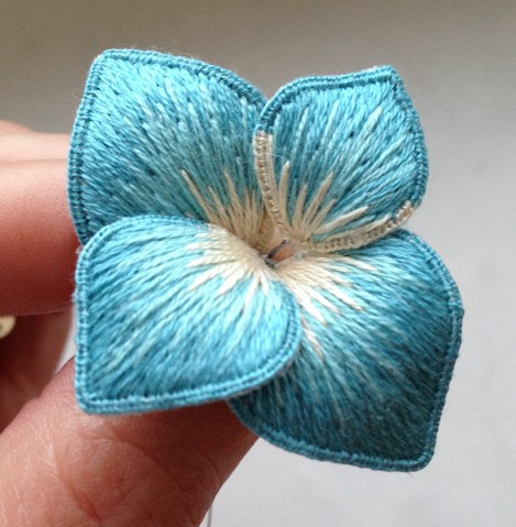 Silk shaded flower for a wedding headdress