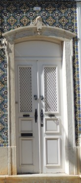 White door and Portuguese tiles