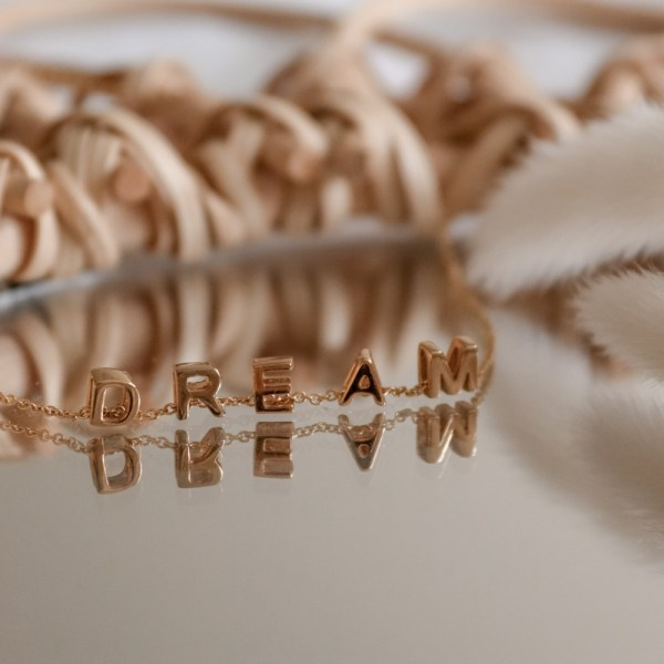 Spell out a word close to your heart with our gold personalised letter charms