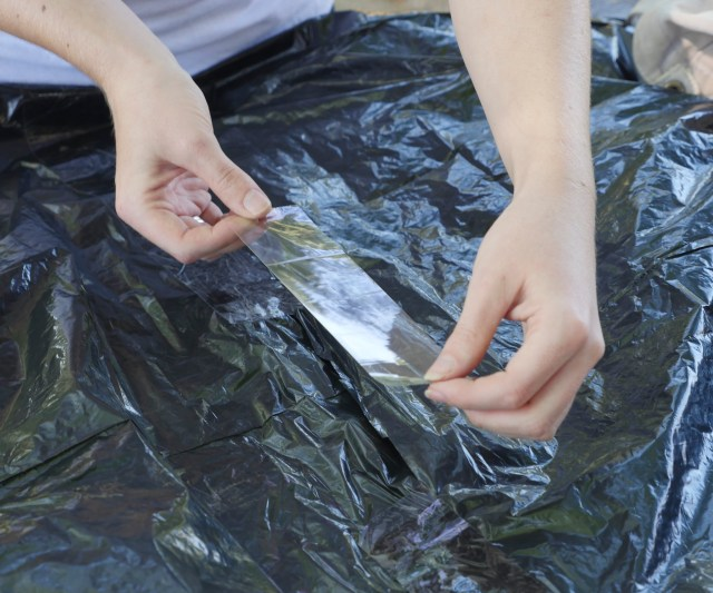 Image of balloon seam being patched with packing tape