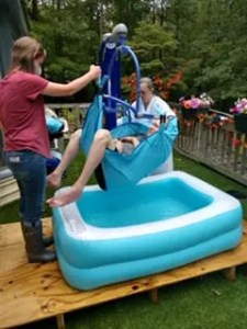 Lowering Lynn into pool for baptism