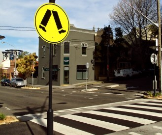 "What I like to call the ""Michael Jackson"" signs--they signal a pedestrian crossing."