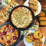 A table full of cakes made with stone fruit Plum, Apricot, Peach